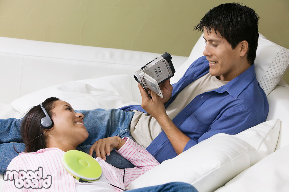 Couple with Portable CD Player and Video Camera