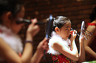 Xavier Mascareñas/Newsday; Huaxia New York Central Chinese School dancer Jada Yang, 12, of Ardsley, applies makeup before performing at the Westchester Chinese New Year Celebration on Feb. 2, 2013.