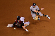 PHOENIX, AZ - APRIL 30:  Trevor Story #27 of the Colorado Rockies turns the double play over the sliding Paul Goldschmidt #44 of the Arizona Diamondbacks in the fourth inning at Chase Field on April 30, 2016 in Phoenix, Arizona.  (Photo by Jennifer Stewart/Getty Images)
