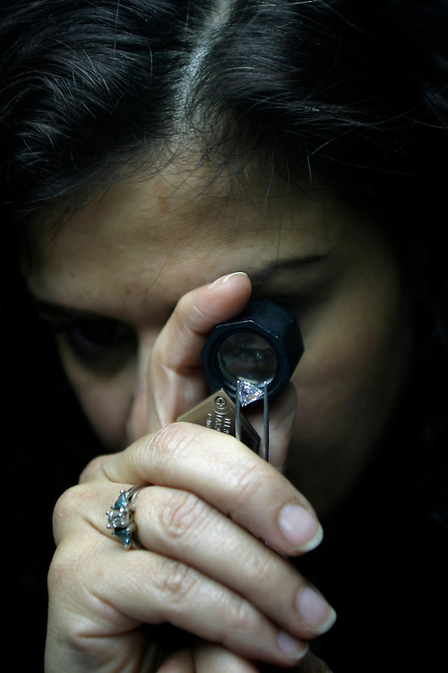 Roni Keller, 43, looking at diamond in the office  of Triad Diamonds Corp in the diamond district in Manhattan on 47th Street and Fifth Ave. on Thursday, February 2, 2007.....