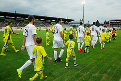 Teams coming to court during 1st Leg football match between NK Domzale (SLO) na FC Cukaricki (SRB) in 1st Round of Europe League 2015/2016 Qualifications, on July 2, 2015 in Sports park Domzale,  Slovenia. Photo by Vid Ponikvar / Sportida