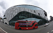 Jul 19, 2019; London, United Kingdom; General overall view of a double decker bus in front of Tottenham Hotspur FC Stadium (White Hart Lane Stadium). The multi-purpose stadium features the world's first dividing, retractable football pitch and a synthetic turf pitch underneath for NFL games, concerts and other events. The Oakland Raiders will play host to the Chicago Bears in the first NFL game in an International Series game on Oct. 6, 2019. Mandatory Credit: Kirby Lee-USA TODAY Sports