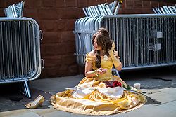 © Licensed to London News Pictures . 30/07/2017 . Manchester , UK . A princess takes a break outside the venue . Cosplayers, families and guests at Comic Con at the Manchester Central Convention Centre . Photo credit : Joel Goodman/LNP