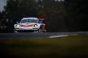 Seth Neiman, Marco Holzer and Nick Tandy, Flying Lizard Motorsports (GT) Porsche 911 GT3 RSR, Petit Le Mans. Oct 18-20, 2012. © Jamey Price