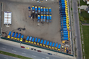 Garbage trucks in parking lot of a Waste Management Facility.