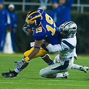 Delaware WR (#19) Nihja White catches a 24 yard pass to the DELAWARE 41, UNH CB (#9) Dino Vasso makes the tackle 1ST DELAWARE. No. 5 Delaware defeats No.11 New Hampshire 16-3 on a brisk Friday night at Delaware stadium in Newark Delaware...Delaware will host the Division I FCS Championship Semifinals Round next weekend.