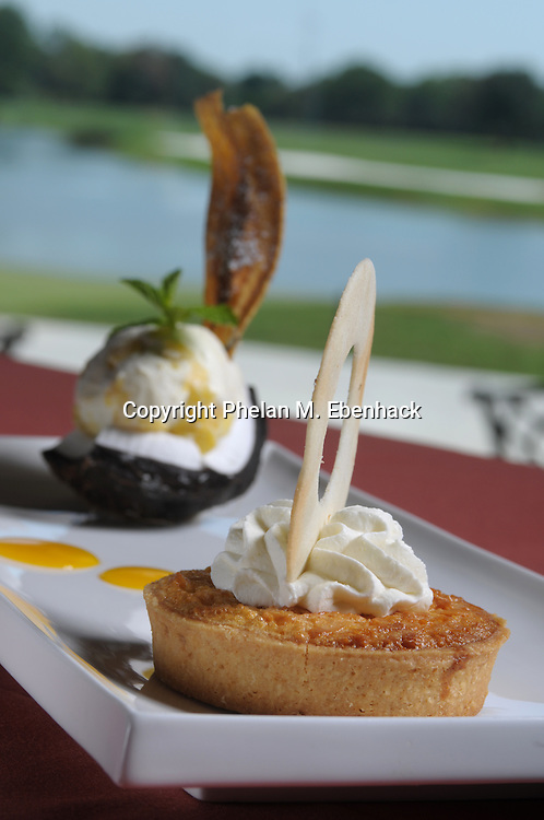 A coconut tart dessert served with pineapple ice cream next to a golf course in Orlando, Florida.