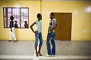 A young model learns how to stand during a rehearsal in Ghana's capital Accra on Thursday May 21, 2009.