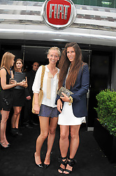 Left to right, MARTHA WARD and ELIZABETH SALTZMAN at a party to launch the Gucci designed Fiat 500 customized by Gucci Creative Director Frida Giannini in collaboration with FIAT's Centro Stile, held at Fiat, 105 Wigmore Street, London on 27th June 2011.