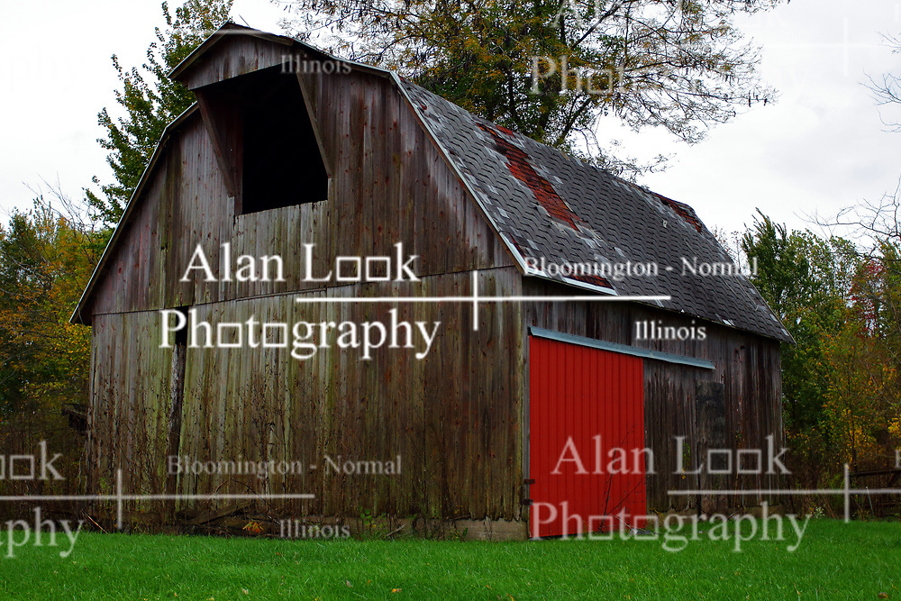 24 October 2017:  A new and brightly painted red door highlight an otherwise rustic looking barn.<br /> <br />  Parke County Indiana is the site of the Indiana Covered Bridge Festival every October