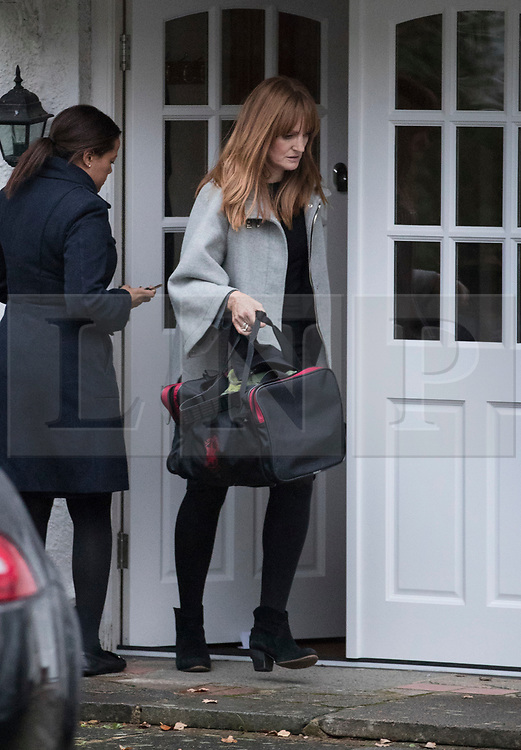 © Licensed to London News Pictures. 04/11/2017. London, UK. Unidentified women are seen with a bag leaving a house in  Wimbledon where a seven year old girl was found seriously injured on Friday who has since died. Robert Peters appeared at Wimbledon Magistrates' Court on Saturday and was charged with attempted murder.  Photo credit: Peter Macdiarmid/LNP