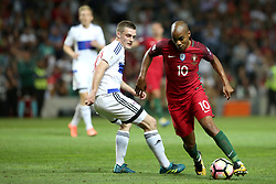 August 31, 2017 - Porto, Portugal - Portugal's midfielder Joao Mario (R ) vies with Faroe Islands' midfielder Solvi Vatnhamar during the 2018 FIFA World Cup qualifying football match between Portugal and Faroe Islands at the Bessa XXI stadium in Porto, Portugal on August 31, 2017. (Credit Image: © Pedro Fiuza/NurPhoto via ZUMA Press)