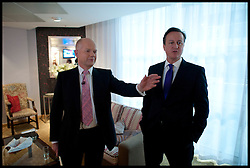 British Prime Minister David Cameron with William Hague in the green room before delivering his speech to delegates on the last day of the Conservative party conference, International Convention Centre, October 10, 2012, Birmingham, England. Photo by Andrew Parsons / i-Images...
