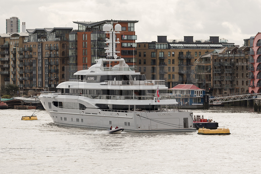 © Licensed to London News Pictures. 29/03/2018. London, UK. The 220ft custom luxury superyacht, 'Global' moored at Butlers Wharf near Tower Bridge during a London visit. Previously named, Kismet during her last central London visit, she underwent a refit which saw her moved up 51 places in Boat International's list of top 200 largest super yachts in the world, boasting numerous luxuries such as a helipad, cinema and jacuzzi. Believed to be owned by Fulham Football Club chairman, Shahid Khan, Global can be chartered for an estimated £1m per week. Powered by 2 Caterpillar (3512 B) 2,038hp diesel engines and propelled by her twin screws propellers, Global is capable of a top speed of 15.5 knots, and comfortably cruises at 14 knots. . Photo credit: Vickie Flores/LNP