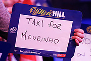 Taxi for Mourinho sign during the Darts World Championship 2018 at Alexandra Palace, London, United Kingdom on 18 December 2018.