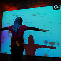 A young girl playing an interactive game at Petrosains, Kuala Lumpur, Malaysia.