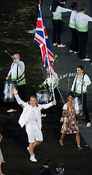 Sir Chris Hoy carries the Team GB flag at the London Olympics opening ceremony , Friday, 27th July 2012  Photo by: i-Images