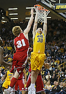 January 19 2013: Iowa Hawkeyes forward Aaron White (30) dunks the ball as Wisconsin Badgers forward Mike Bruesewitz (31) tries for a block during the first half of the NCAA basketball game between the Wisconsin Badgers and the Iowa Hawkeyes at Carver-Hawkeye Arena in Iowa City, Iowa on Sautrday January 19 2013. Iowa defeated Wisconsin 70-66.