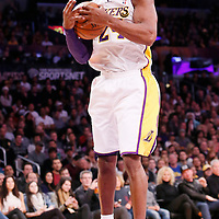 08 December 2013: Los Angeles Lakers shooting guard Kobe Bryant (24) grabs a rebound during the first half to the game between the Los Angeles Lakers and the Toronto Raptors at the Staples Center, Los Angeles, California, USA.