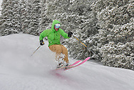Graham Sparks slices through fresh powder on Aspen Mountain while using a pair of his own handmade skis.