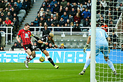 Pierre-Emile Hojbjerg (#23) of Southampton wins the ball rom Joelinton (#9) of Newcastle United in the penalty box during the Premier League match between Newcastle United and Southampton at St. James's Park, Newcastle, England on 8 December 2019.