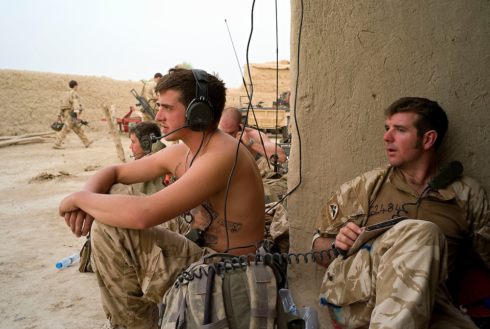 British soldiers of 3rd Battalion The Parachute Regiment monitor communications at their temporary patrol base after an airborne assault as part of Operation 'Southern Beast'. Kandahar Province, Afghanistan on the 4th of August 2008.