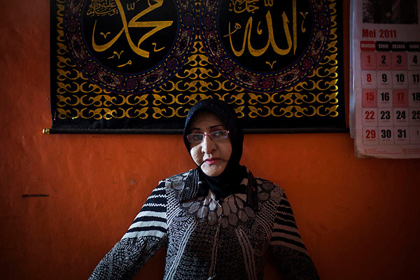A portrait of shintha 50years old. she one of the waria that always wear a muslim woman dress every she go out from her house. she is the member  of the Al-Fatah Center, Yogyakarta, Indonesia . The Al-Fatah Center is a place for transvestites to learn islam and pray this breaking with the norm in the world's most populous Muslim country Indonesia