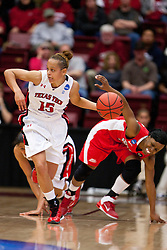 March 19, 2011; Stanford, CA, USA; Texas Tech Lady Raiders guard Casey Morris (15) dribbles past St. John's Red Storm forward Da'Shena Stevens (3) during the second half of the first round of the 2011 NCAA women's basketball tournament at Maples Pavilion. St. John's defeated Texas Tech 55-50.