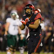 22 September 2018: San Diego State Aztecs safety Tariq Thompson (14) signals a play to a teammate during the fourth quarter. The San Diego State Aztecs beat the Eastern Michigan Eagles 23-20 in over time at SDCCU Stadium in San Diego, California.