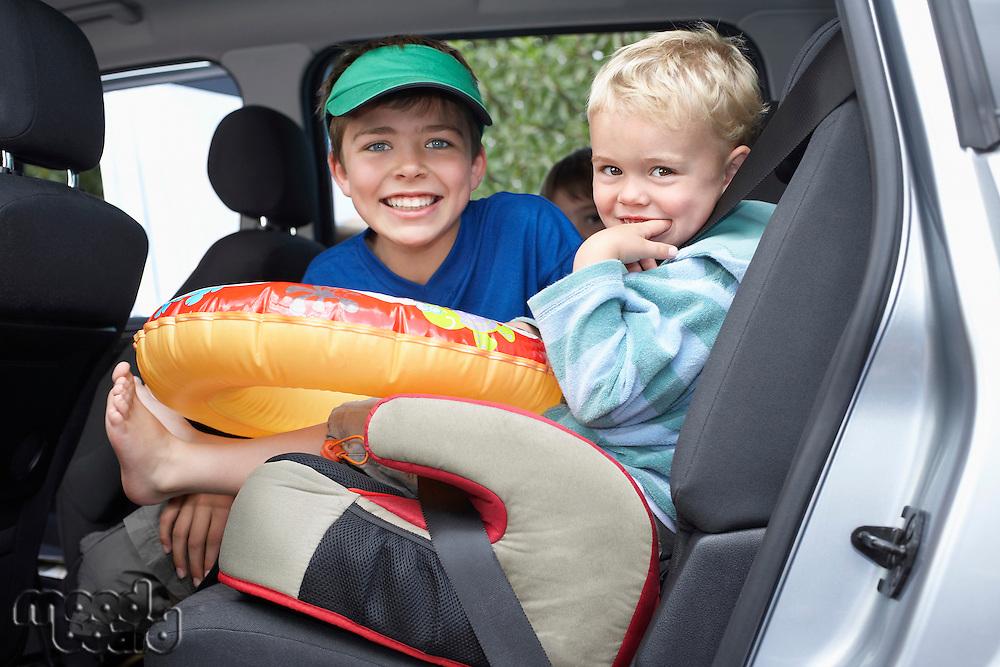 Three boys (3-11) in car portrait