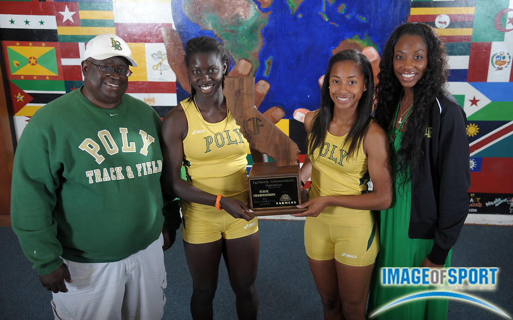 Jun 7, 2011; Long Beach, CA, USA; Long Beach Poly coach Don Norford (left), Akawkaw Ndipagbor (second from left), Melia Cox (second from right) and coach Crystal Irving pose with the 2011 CIF State Girls Championship trophy at Poly High.