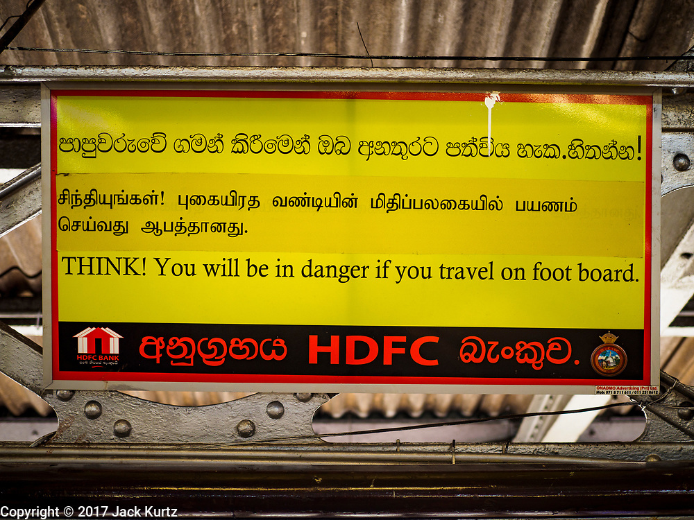 07 OCTOBER 2017 - COLOMBO, SRI LANKA: A sign warns of the dangers of riding on the footboard of a train at the Fort Station in Colombo. The Fort Station is Colombo's main train station and serves as the hub of Sri Lanka's train system. The station opened in 1917 and is modeled after Manchester Victoria Station.    PHOTO BY JACK KURTZ
