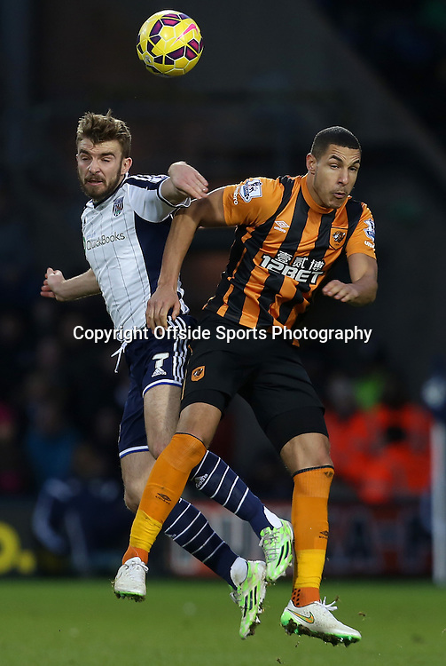 10th January 2015 - Barclays Premier League - West Bromwich Albion v Hull City - James Morrison of West Bromwich Albion and Curtis Davis of Hull City contest a high ball - Photo: Paul Roberts / Offside.