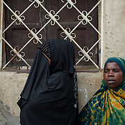 Relatives of Abdul Masumbuko, a young man allegedly killed by a grenade he was handling in Jade neighbourhood in Bujumbura, mourn his death at the yard of the family house, June 28, 2005.