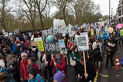 © Licensed to London News Pictures. 29/11/2015. London, UK. Protesters take part in the People's March for Climate, Justice and Jobs in central London. Marchers are calling for world leaders take further measures to combat climate change and environmental issues. Demonstrations are taking place around the globe today to demand United Nations action against climate change, calling on world leaders to cease political posturing and commit to a concrete international plan for people affected by climate change at the UN Paris Climate Change Summit. Photo credit : Vickie Flores/LNP