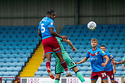 Yann Songo'o of Scunthorpe United heads the ball towards goal but is saved during the EFL Sky Bet League 2 match between Scunthorpe United and Carlisle United at Sands Venue Stadium, Scunthorpe, England on 31 August 2019.