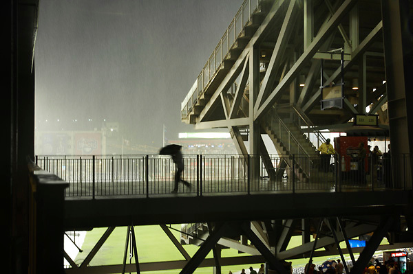 04 June 2008:  Fans take cover as a heavy rain falls before the game between the St. Louis Cardinals and the Washington Nationals.  The game was postponed because of rain at Nationals Park in Washington, D.C.   ****For Editorial Use Only****