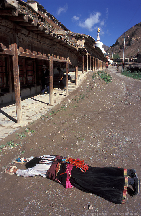 The pilgrimage is mainly to follow the pilgrimís route around the monastic village. Some of them choose to follow the route doing prostrations towards the village and the temples..LAMBRANG MONASTERY IN XIAHE - CHINA.copyright: Androniki Christodoulou.