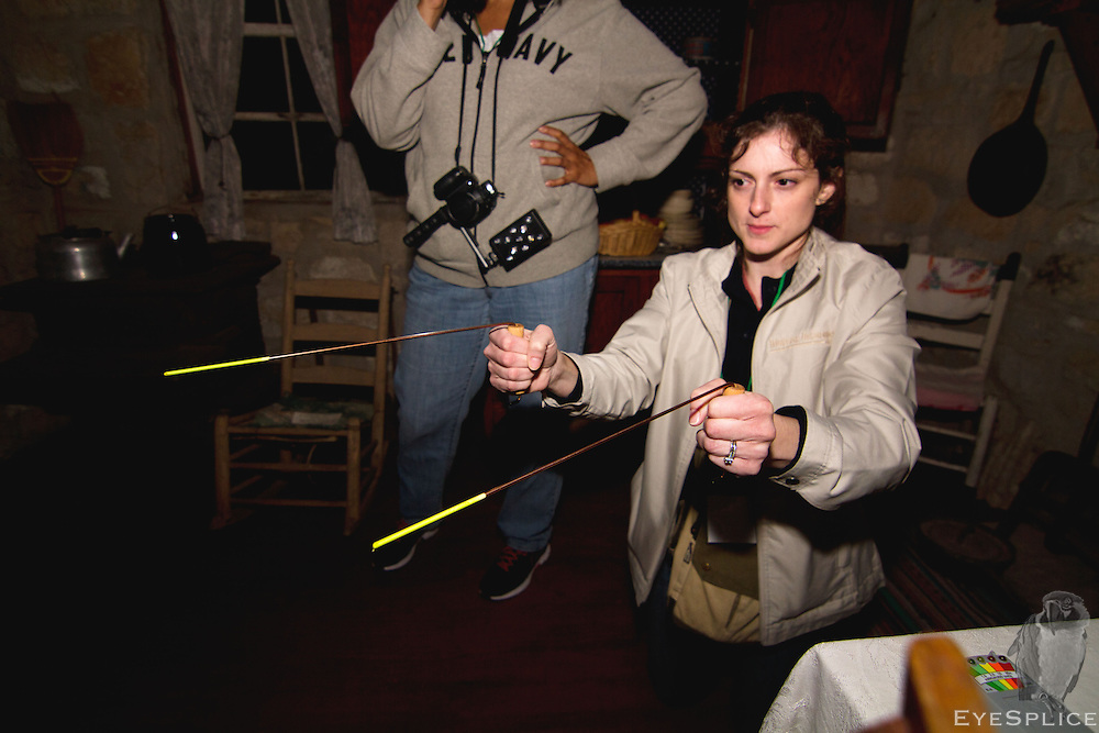 Investigators use a number of instruments and devices to connect with the paranormal world. One such set of tools are divining rods. Here, Emily Eakin of Austin, TX uses a set of divining rods to reach the paranormal. Investigators in the room with her ask questions of the spirits. The spirits are then asked to move toward the rods, thus moving them closer together for an affirmative answer. Once questions were asked, the rods then moved in accordance with a semblance of an answer. Questions were asked such as: 'Were you a slave? Do you want us to leave?' Followed by: 'If so, please move closer to cross the rods.' Which happened several times, consistently.