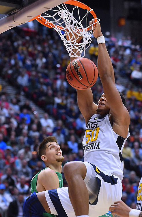 SAN DIEGO, CA - MARCH 18:  West Virginia Mountaineers forward Sagaba Konate (50) dunks against the Marshall Thundering Herd during a second round game of the Men's NCAA Basketball Tournament at Viejas Arena in San Diego, California.  (Photo by Sam Wasson)