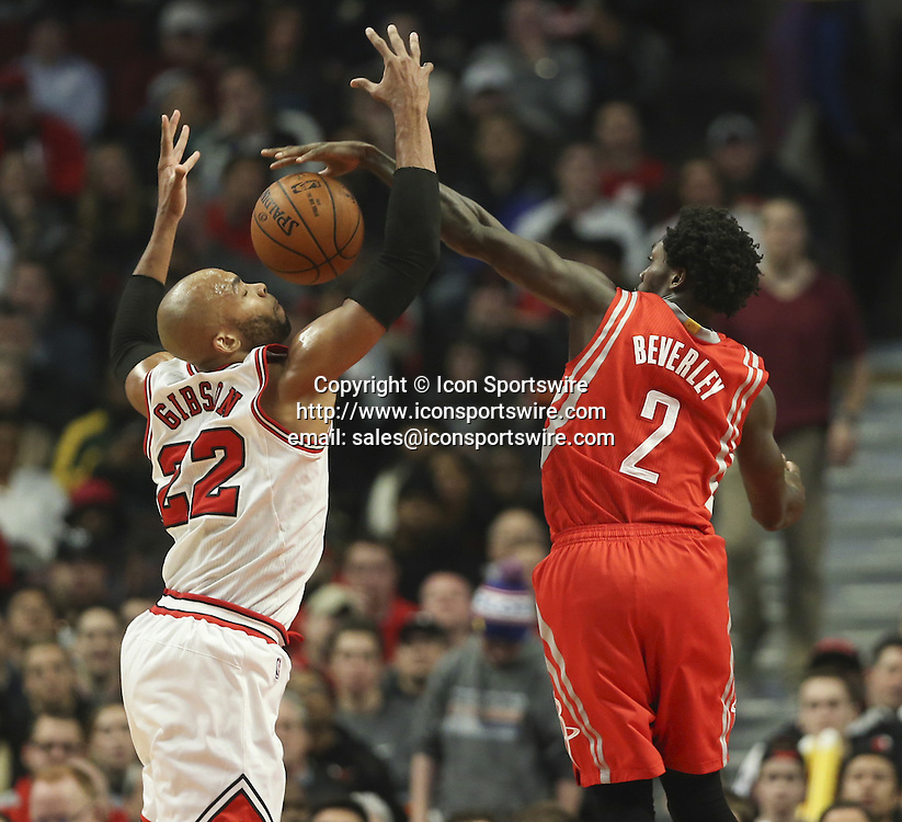 Jan. 5, 2015 - Chicago, IL, USA - Chicago Bulls forward Taj Gibson (22) is fouled by Houston Rockets guard Patrick Beverley (2) during the first half on Monday, Jan. 5, 2015, at the United Center in Chicago