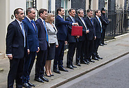 The Chancellor of The Exchequer George Osborne stands with his team and holds up his dispatch box outside 11 Downing Street on Budget Day in Westminster, London.<br /> Picture by Paul Davey/Focus Images Ltd +447966 016296<br /> 16/03/2016