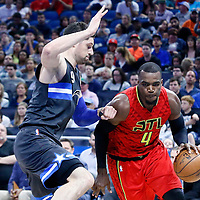 25 February 2017: Atlanta Hawks forward Paul Millsap (4) drives past Orlando Magic center Nikola Vucevic (9) during the Orlando Magic 105-86 victory over the Atlanta Hawks, at the Amway Center, Orlando, Florida, USA.