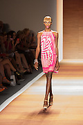 An pink and white print halter dress, with assymmetrical print.