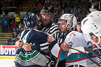 KELOWNA, CANADA - APRIL 23: Linesman Mike Roberts gets between Garan Magnes #14 of Seattle Thunderbirds and Riley Stadel #3 of Kelowna Rockets during first period on April 23, 2016 at Prospera Place in Kelowna, British Columbia, Canada.  (Photo by Marissa Baecker/Shoot the Breeze)  *** Local Caption *** Mike Roberts; Riley Stadel; Garan Magnes;
