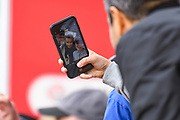 Leeds United owner Andrea Radrizzani takes a selfie with a fan during the EFL Sky Bet Championship match between Barnsley and Leeds United at Oakwell, Barnsley, England on 15 September 2019.
