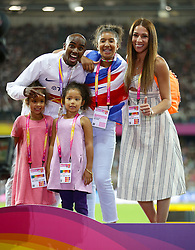 Great Britain's Mo Farah on the podium with wife Tania and daughters Rhianna, Amani and Aisha after winning silver in the Men's 5000m Final during day nine of the 2017 IAAF World Championships at the London Stadium. Picture date: Saturday August 12, 2017. See PA story ATHLETICS World. Photo credit should read: Yui Mok/PA Wire. RESTRICTIONS: Editorial use only. No transmission of sound or moving images and no video simulation.