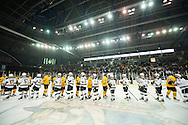 The teams shake hands during the men's hockey game between the Vermont Catamounts and the Quinnipiac Bobcats in the championship game of the Friendship Four hockey tournament at the SSE Arena on Saturday evening November 26, 2016 in Belfast, Ireland. (BRIAN JENKINS/for the FREE PRESS)