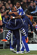 Edu celebrates with Jefferson Farfan during the UEFA Champions League round of 16 second leg match between Schalke 04 and Valencia at Veltins Arena on March 9, 2011 in Gelsenkirchen, Germany.