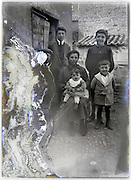 family portrait on a severely eroded glass plate